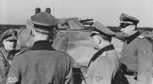 20 Sd.Kfz. 251 fitted with flame projectors from 12. SS Panzer Division Hitlerjugend being inspected by officers at the Beverloo Training Ground.jpg