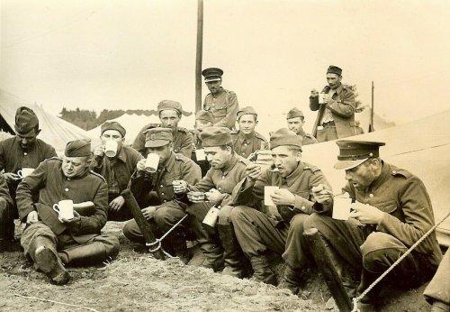 Captured Polish POW's Enjoy Food in German Camp; 1939.jpg