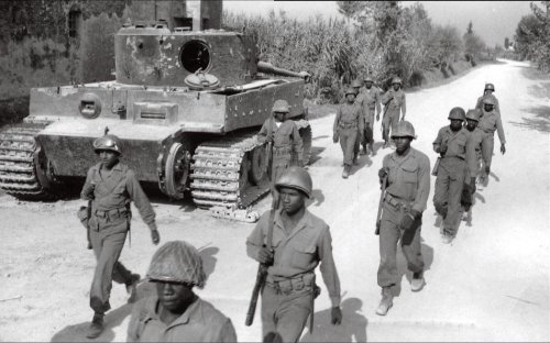 US soldiers walk past an abandoned Tiger I tank that was undergoing maintenance in Italy, 1944.jpg