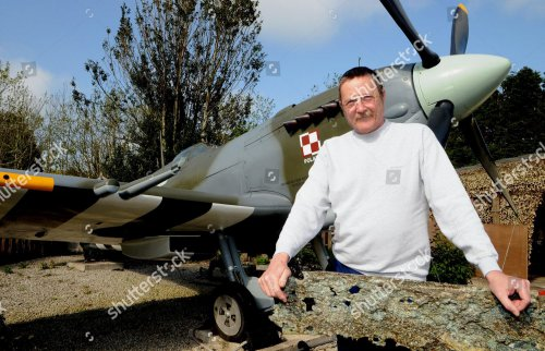 barry-wallond-with-his-replica-ww2-spitfire-near-raf-st-mawgan-cornwall-britain-may-2011-shutterstock-editorial-1334351d.jpg